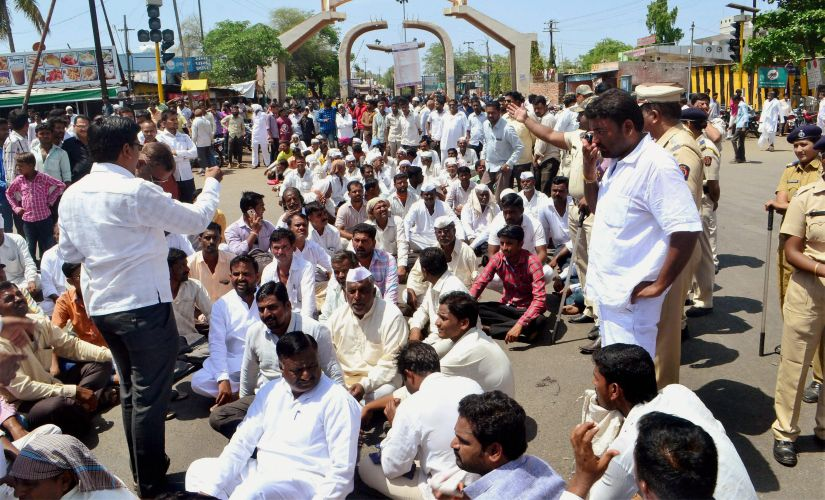Farmers block the road during a protest as part of the Maharashtra bandh over various demands in Solapur on Monday. PTI
