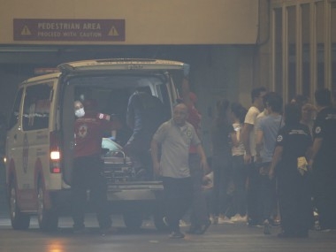 People being taken to hospitals in ambulances after the attack. AP