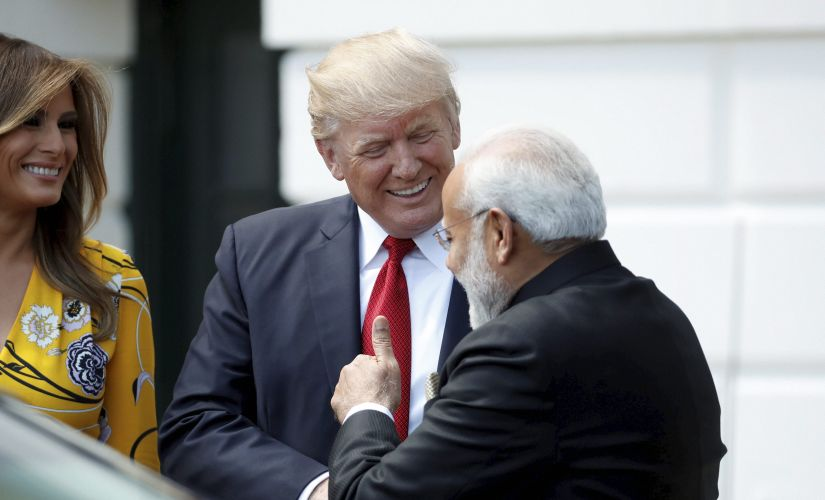 President Donald Trump and first lady Melania Trump greet Indian Prime Minister Narendra Modi to the White House in Washington on Monday. AP