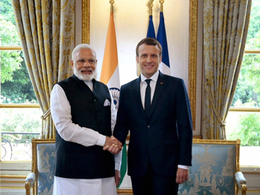 Prime Minister Narendra Modi with French president Emmanuel Macron in Paris on Saturday. PTI