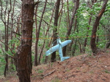 In this Friday, June 9, 2017 photo provided by South Korean Defense Ministry on Tuesday, June 13, 2017, a suspected North Korean drone is seen in a mountain in Inje, South Korea. South Korean Defense Ministry said on Tuesday, June 13, 2017, the suspected North Korean drone found near the Korean border was found to have taken photos of a U.S. missile defense shield in the South. Investigators discovered hundreds of photos from the drone's Sony-made in-built camera.