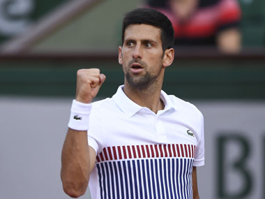 Novak Djokovic celebrates after winning a point against Spain's Albert Ramos-Vinolas at French Open 2017. AFP