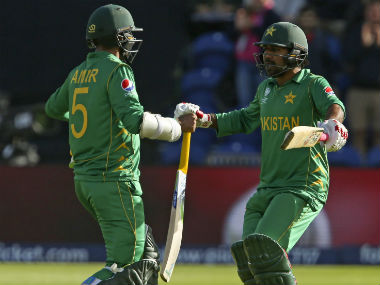 Mohammad Amir (L) celebrates with Sarfraz Ahmed after Pakistan's victory over Sri Lanka in the Champions Trophy. AFP
