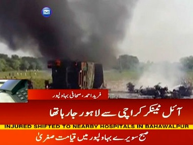 In this image taken from video, black smoke rises from oil tanker on road in Bahawalpur, Pakistan, Sunday. AP