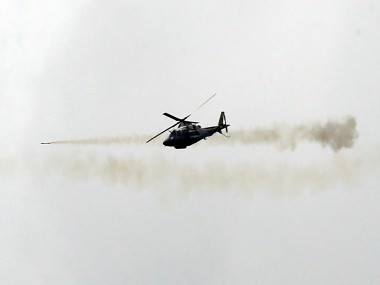 A Philippine Air Force attack helicopter fires a rocket. Reuters