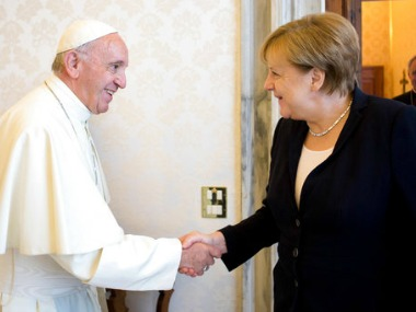 Pope Francis and German chancellor Angela Merkel shake hands on the occasion of their private audience at the Vatican on 17 June. AP