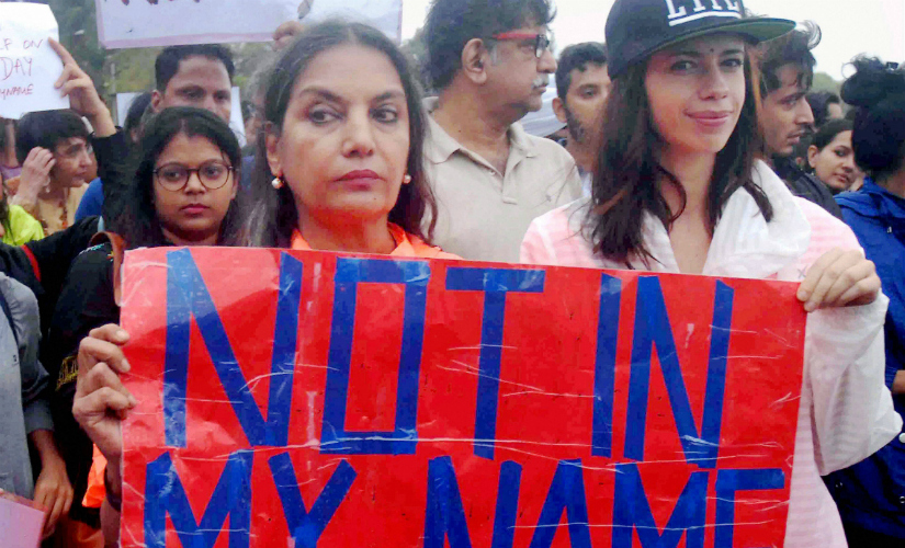 "Mumbai : Bollywood actors Shabana Azmi and Kalki Koechlin participating the silent protest ""Not in My Name"" against the incidents of targeted lynching, in Mumbai on Wednesday. PTI"