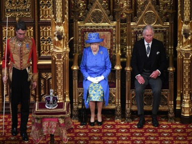 Queen Elizabeth II and Prince Charles sit in the House of Lords at the official State Opening of Parliament. AP