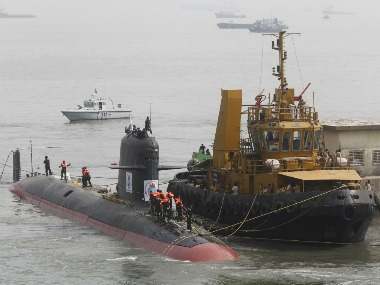 File photo of Indian Navy's Scorpene submarine INS Kalvari being escorted by tugboats as it arrives at Mazagon Docks in Mumbai. Reuters