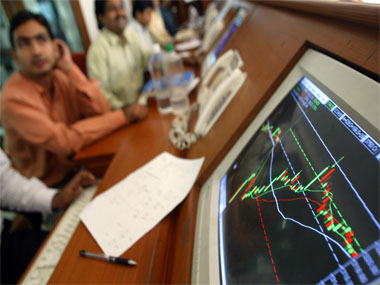 Indian stock brokers watch the key Sensex share index graph in a brokerage firm in Bombay May 13, 2004. Indian financial markets rebounded by mid-morning on Thursday on hopes the main opposition Congress Party will be able to form a stable government, reversing sharp early losses sparked by fears of a hung parliament. REUTERS/Punit Paranjpe PP/SH