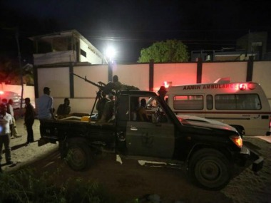 Armed security forces and rescue personnel are seen at the scene of an attack outside an hotel in Mogadishu. Reuters