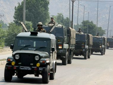 Army vehicles near Delhi Public School during an encounter with the militants at Pantha Chowk in Srinagar on Sunday. PTI