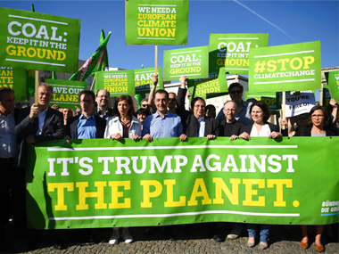 File image of protest against Donald Trump's decision to exit the Paris Climate agreement in Berlin. AP