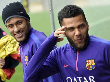 "Barcelona's Brazilian forward Neymar da Silva Santos Junior (L) and Barcelona's Brazilian defender Dani Alves (R) joke during a training session at the Sports Center FC Barcelona Joan Gamper in Sant Joan Despi, near Barcelona on March 21, 2015 on the eve of the ""clasico"" the Spanish league football match FC Barcelona vs Real Madrid CF. AFP PHOTO/ LLUIS GENE / AFP PHOTO / LLUIS GENE"