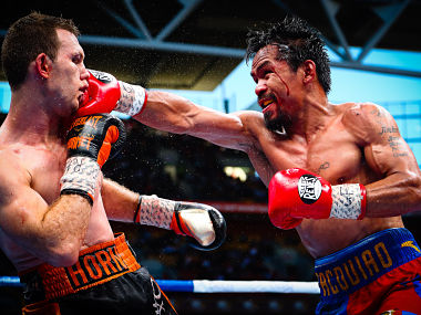 "Manny Pacquiao (R) of the Philippines fight Jeff Horn (L) of Australia during the World Boxing Organization boat at Suncorp Stadium in Brisbane on July 2, 2017. / AFP PHOTO / Patrick HAMILTON / -- IMAGE RESTRICTED TO EDITORIAL USE - STRICTLY NO COMMERCIAL USE -- / ""The erroneous mention[s] appearing in the metadata of this photo by Patrick HAMILTON has been modified in AFP systems in the following manner: [July 2] instead of [July 1]. Please immediately remove the erroneous mention[s] from all your online services and delete it (them) from your servers. If you have been authorized by AFP to distribute it (them) to third parties, please ensure that the same actions are carried out by them. Failure to promptly comply with these instructions will entail liability on your part for any continued or post notification usage. Therefore we thank you very much for all your attention and prompt action. We are sorry for the inconvenience this notification may cause and remain at your disposal for any further information you may require."""