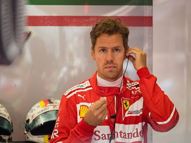 Ferrari's German driver Sebastian Vettel prepares for the third practice session of the Formula One Austria Grand Prix at the Red Bull Ring in Spielberg, on July 8, 2017. / AFP PHOTO / ANDREJ ISAKOVIC