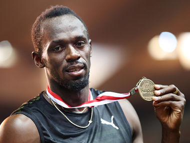 Jamaica's Usain Bolt poses with his gold medal after winning the men's 100m event at the IAAF Diamond League athletics meeting in Monaco on July 21, 2017. / AFP PHOTO / Valery HACHE