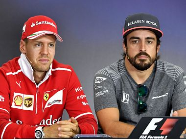 McLaren's Spanish driver Fernando Alonso (R) and Ferrari's German driver Sebastian Vettel attends a press conference ahead at the Hungaroring circuit in Budapest on July 27, 2017 prior to the weekend's Hungarian Formula One Grand Prix. AFP PHOTO / ANDREJ ISAKOVIC / AFP PHOTO / ANDREJ ISAKOVIC