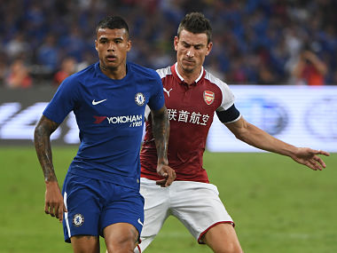 (FILES) This file photo taken on July 22, 2017 shows Chelsea's Kenedy (L) competing for the ball with Arsenal's Laurent Koscielny during their pre-season football match in Beijing's National Stadium. Kenedy's offensive social media posts about China sparked calls for his club Chelsea to be banned from the country and were a spectacular own goal in a lucrative market. Experts say that while the controversy will have only limited impact on Chelsea's popularity in China, it serves as a warning to European clubs chasing riches in the world's second-biggest economy. / AFP PHOTO / GREG BAKER