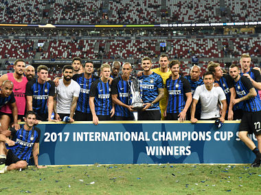 Inter Milan's team poses for photographers after defeating Chelsea in their International Champions Cup final in Singapore. AFP