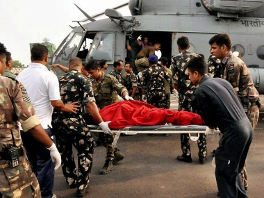 Injured pilgrims and passengers being taken to hospital by the rescue team of IAF. PTI