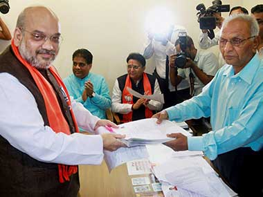 BJP president Amit Shah handovers his nomination for Rajya Sabha election to election officer BM Patel in Gandhinagar. PTI