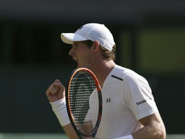 Britain's Andy Murray celebrates winning a point against Germany's Dustin Brown during their Men's Singles Match on day three at the Wimbledon Tennis Championships in London Wednesday, July 5, 2017. (AP Photo/Tim Ireland)