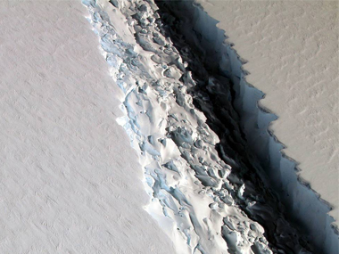 File image of the an oblique view of a massive rift in the Antarctic Peninsula's Larsen C ice shelf. NASA