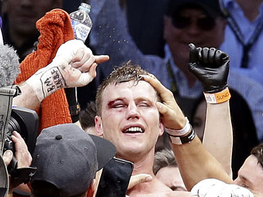 Jeff Horn of Australia celebrates after beating Manny Pacquiao of the Philippines during their WBO World welterweight title fight in Brisbane, Australia, Sunday, July 2, 2017. (AP Photo/Tertius Pickard)