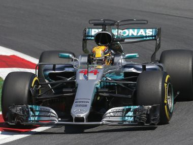Mercedes driver Lewis Hamilton steers his car during the first free practice session. AP