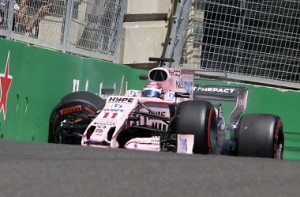 Force India driver Sergio Perez of Mexico sits in his car after crashing during the first free practice at the Formula One Azerbaijan Grand Prix in Baku, Azerbaijan, Friday, June 23, 2017. (AP Photo/Darko Bandic)