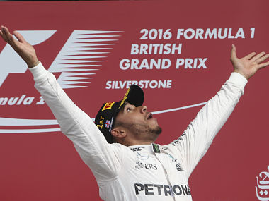 FILE - In this file photo dated Sunday, July 10, 2016, Britain's Mercedes driver Lewis Hamilton celebrates on the podium after winning the British Formula One Grand Prix at the Silverstone racetrack, Silverstone, England. The future of the British Grand Prix at Silverstone is under threat after the circuit's owners, British Racing Drivers' Club triggered a break clause in its contract, saying it lost 2.8 million pounds (now about $3.5 million) in 2015, and 2019 will be the last unless F1 owner Liberty reduces the race fee. (AP Photo/Luca Bruno, FILE)
