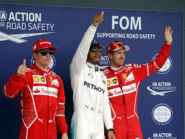 Ferrari driver Kimi Raikkonen of Finland, Mercedes driver Lewis Hamilton of Britain and Ferrari driver Sebastian Vettel of Germany, from left to right, wave to fans after the qualifying session for the British Formula One Grand Prix at the Silverstone racetrack in Silverstone, England, Saturday, July 15, 2017. The British Formula One Grand Prix will be held on Sunday, July 16. Hamilton clocked the fastest time, Raikkonen was second and Vettel third. (AP Photo/Frank Augstein)