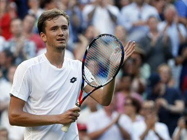 Russia's Daniil Medvedev celebrates after winning his Men's Singles Match against Switzerland's Stan Wawrinka, on the opening day.AP