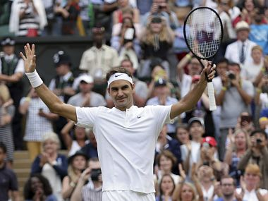 Switzerland's Roger Federer celebrates after beating Germany's Mischa Zverev in their Men's Singles Match on day six at the Wimbledon Tennis Championships in London Saturday, July 8, 2017. (AP Photo/Tim Ireland)