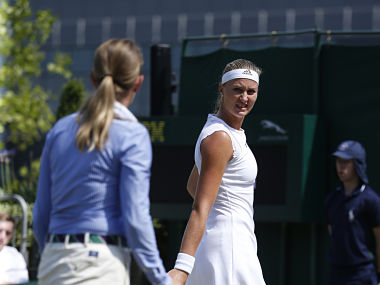 Kristina Mladenovic of France complains to officials about the state of the court during her Women's Singles Match against Alison Riske of the United States on day four at the Wimbledon Tennis Championships in London Thursday, July 6, 2017. (AP Photo/Alastair Grant)