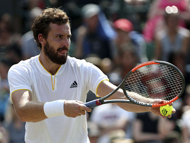 Latvia's Ernests Gulbis prepares to serve to Argentina's Juan Martin Del Potro during their Men's Singles Match at the Wimbledon Tennis Championships in London Thursday, July 6, 2017. (Gareth Fuller/PA via AP)