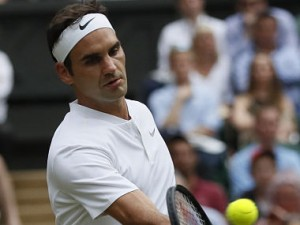 Switzerland's Roger Federer in action against Serbia's Dusan Lajovic at the Wimbledon Tennis Championships. (AP Photo)