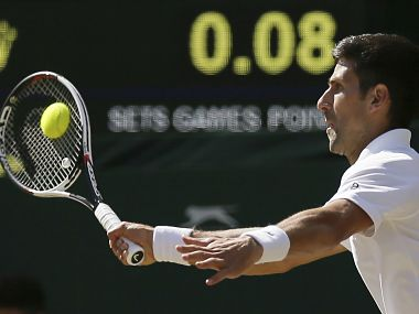 Serbia's Novak Djokovic returns to Latvia's Ernests Gulbis during their Men's Singles Match on day six at the Wimbledon Tennis Championships in London Saturday, July 8, 2017. (AP Photo/Tim Ireland)