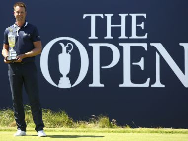Defending champion Henrik Stenson poses for photographs with the Claret Jug ahead of the 2017 British Open. AP