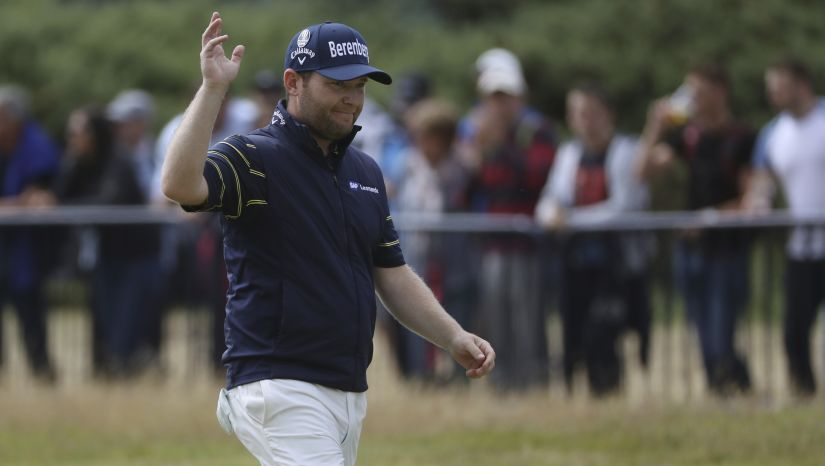 South Africa's Branden Grace waves as he makes his way along the 18th fairway during the third round of the British Open. AP