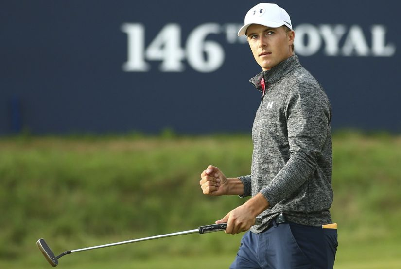 Jordan Spieth of the United States celebrates on the 18th green after the third round of the British Open. AP