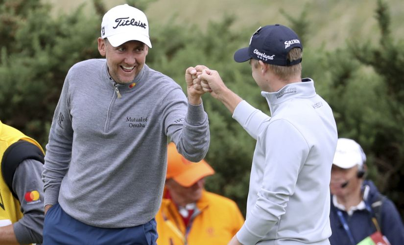 Ian Poulter, left, and Russell Knox congratulate each other on their long putts on the 9th hole during the second round of the British Open. AP