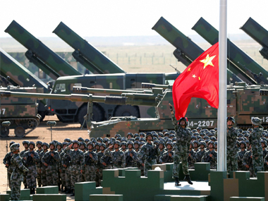 Chinese People's Liberation Army (PLA) troops perform a flag raising ceremony Sunday, July 30, 2017 for a military parade to commemorate the 90th anniversary of PLA. AP