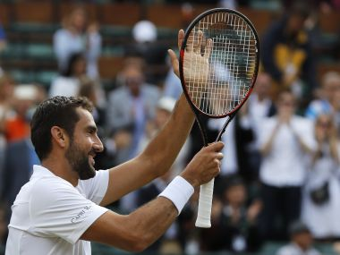 Croatia's Marin Cilic celebrates after beating Luxembourg's Gilles Muller at the end of their Men's Singles Quarterfinal Match on day nine at the Wimbledon Tennis Championships in London Wednesday, July 12, 2017. (AP Photo/Alastair Grant)