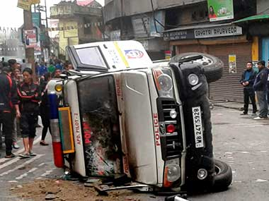 A damaged police vehicle in violence after the alleged death of a youth in police firing in Darjeeling. PTI