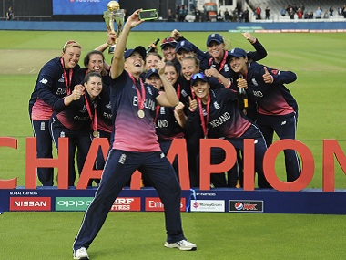 England's Katherine Brunt takes a selfie as England players celebrate with the trophy. AP