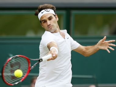 Roger Federer of Switzerland hits a shot during his Men's Singles Final match against Novak Djokovic of Serbia at the Wimbledon Tennis Championships in London, July 12, 2015. REUTERS/Stefan Wermuth - RTX1K2M3