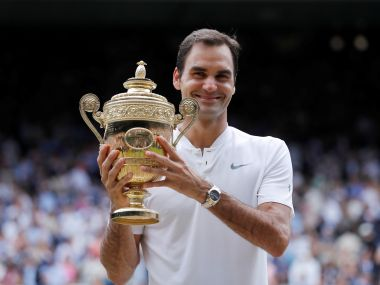 Roger Federer lifts his 8th Wimbledon trophy. Reuters