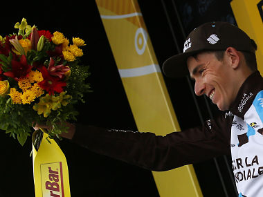 Stage winner France's Romain Bardet celebrates on the podium after the twelfth stage of the Tour de France cycling race over 214.5 kilometers (133.3 miles) with start in Pau and finish in Peyragudes, France, Thursday, July 13, 2017. (AP Photo/Peter Dejong)
